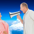 Man shouting at his partner through megaphone — Stock Photo #62489295