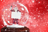 Santa ringing bell and holding sign — Stock Photo