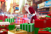 Santa delivering gifts from cart — Stock Photo