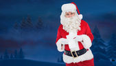 Happy santa holding paper and pen — Foto de Stock