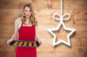 Pretty blonde showing hot cookies — Stock Photo