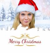 Blonde with bare shoulders in santa hat — Stock Photo