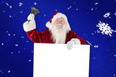 Santa holds sign and rings — Stock Photo