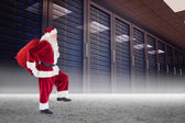 Santa carrying sack of gifts — Stock Photo