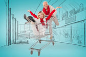 Happy festive couple messing in trolley — Stock Photo