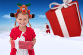 Cute little girl wearing rudolph headband — Stock Photo