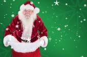 Santa ouvrir son sac rouge — Photo