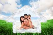 Composite image of family on the beach — Stockfoto