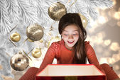 Composite image of little girl getting gift — Foto de Stock