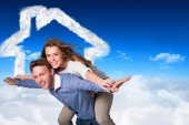 Smiling young man carrying woman — Stock Photo