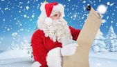 Santa checking list — Stock Photo