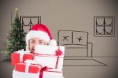 Festive blonde holding pile of gifts — Stok fotoğraf