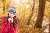 Cold redhead wearing coat and hat — Stock Photo