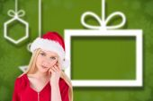 Composite image of festive blonde looking at camera — Stock Photo