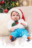 Baby boy on couch at christmas — Stock Photo