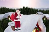 Santa on cottage roof — Stock Photo