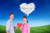 Couple holding a red heart — Stock Photo