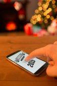 Hand using smartphone at christmas — Stockfoto