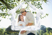 Cute couple standing in the park embracing — Foto de Stock