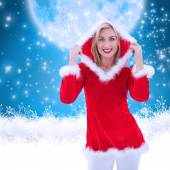 Festive blonde smiling at camera — Stock Photo