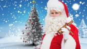 Santa claus holding beer and cigar — Stock Photo