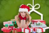 Composite image of woman in santa hat laying — Stock Photo
