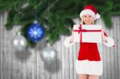 Composite image of festive blonde holding a gift — Zdjęcie stockowe