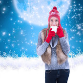 Woman in winter clothes holding mug — Stock Photo