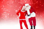 Santa and mrs claus smiling at camera — Stock Photo