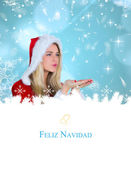 Composite image of pretty girl in santa outfit blowing — Stock Photo