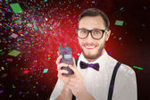 Geeky hipster holding retro cellphone — Stock Photo