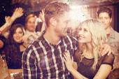 Stylish couple smiling and dancing together — Stock Photo