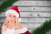 Composite image of festive blonde blowing a kiss — Foto Stock