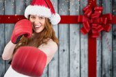 Festive redhead punching with boxing gloves — Stock Photo