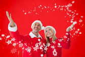 Festive couple against red — Stok fotoğraf