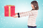 Surprised brunette holding a gift — Foto de Stock