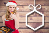 Festive blonde eating hot cookies — Stock Photo