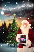 Santa presents tablet PC — Photo