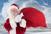 Santa carries bag and smiles — Stock Photo