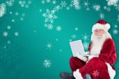 Santa sits and uses laptop — Foto Stock