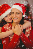 Festive mother and daughter smiling — Photo