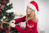 Woman decorating a Christmas tree — Stock Photo