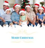 Family in santa hats celebrating christmas — Stock Photo