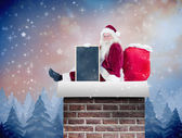 Santa sits leaned on his bag — Foto de Stock