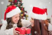 Festive mother and daughter smiling — Stock Photo