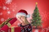 Blonde opening gift — Stock Photo