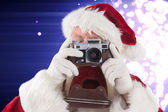 Santa is taking a picture — Stockfoto
