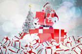 Santa standing in large gift — Stock Photo