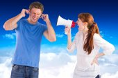 Woman shouting through a megaphone — Stock Photo