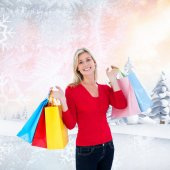 Happy blonde holding shopping bags — Stock Photo
